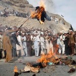 Afghans near Kabul burn Pastor Terry Jones in effigy.