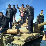People_on_a_tank_in_Benghazi Libya