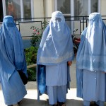 Muslim women in burqas