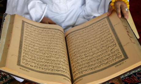 man reading Koran