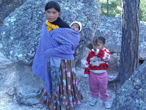 mother and chldren kids poor native baby outside family