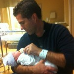 Tagg Romney and one of his newborn sons (via Twitter)
