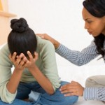 woman consoling crying teen